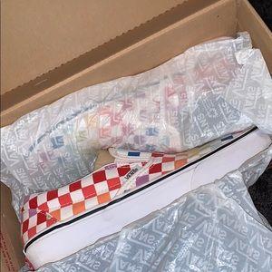 Classic Slip On Rainbow Checkerboard Vans